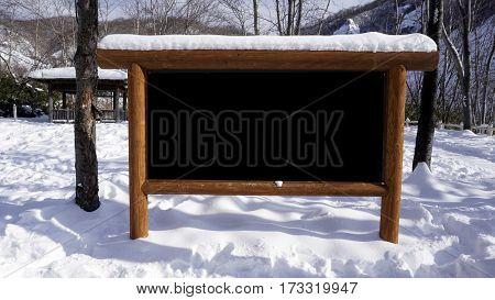 Blank Signage Wood Frame In The Forest Snow Winter