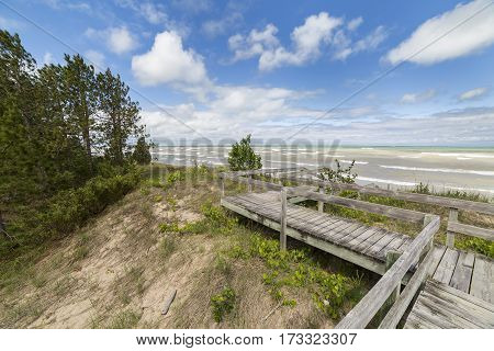 Boardwalk Through A Sand Dune Ecosystem Next To Lake Huron
