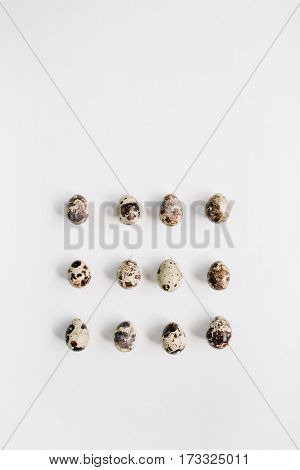 Quail eggs on white background. Flat lay top view. Easter concept.