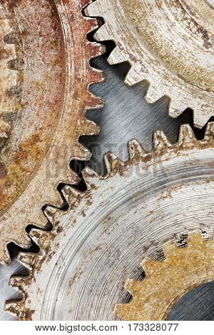 Old Worn Out Gear Cogwheels With Rust On Scratched Background. High Resolution.