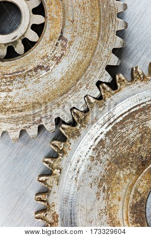 Old Gears With Rust On Scratched Industrial Background Macro