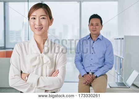 Portrait of pretty smiling Korean business lady