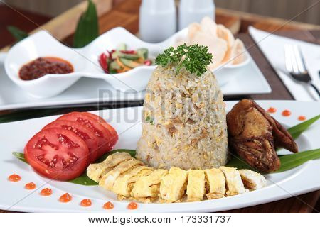 Indonesia famous fried rice portion in plate with complete  condiment