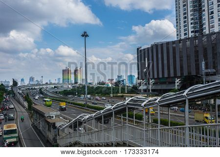 Traffic at main street and high buildings around with cloudy sky as background photo taken in Jakarta Indonesia java