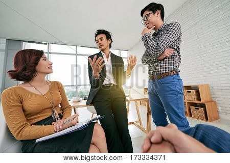 Business people discussing ways to develop the company