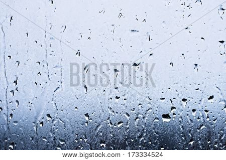 Glass With Condensation, Natural Water Drops On Glass, High Humidity, Large Drops Of Water Flow Down