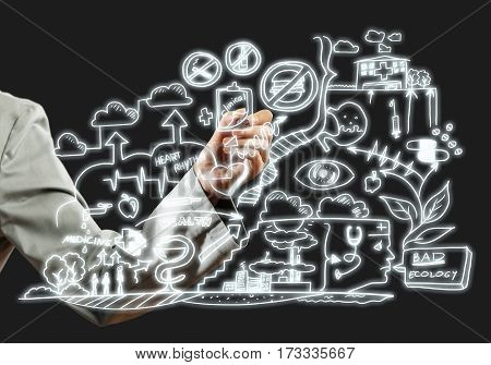 Close view of businesswoman drawing ecology concept on screen