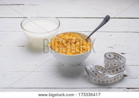 Sports Breakfast, Corn Flakes And Milk In A Bowl On A Wooden Table.