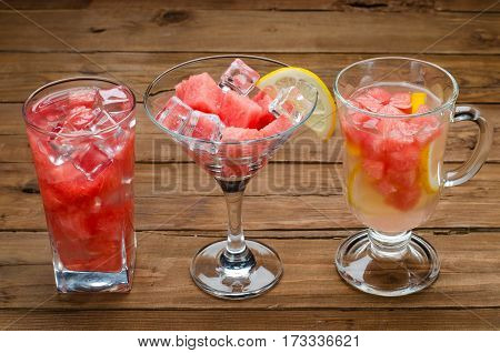 Watermelon Cocktail In A Glass And Slices Of Juicy Watermelon In A Glass Of Martini On A Brown Woode