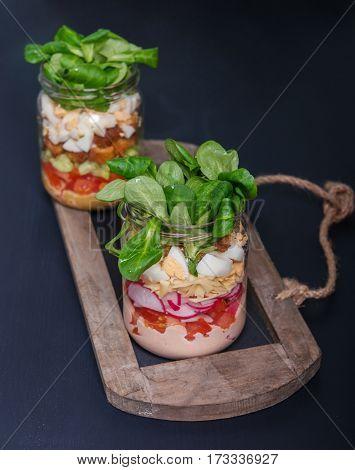 Two glass jars with fresh salad