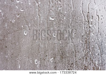 Rain Drops On Glass With A Background. Glass With Condensation. Natural Water Drops On Glass. High H