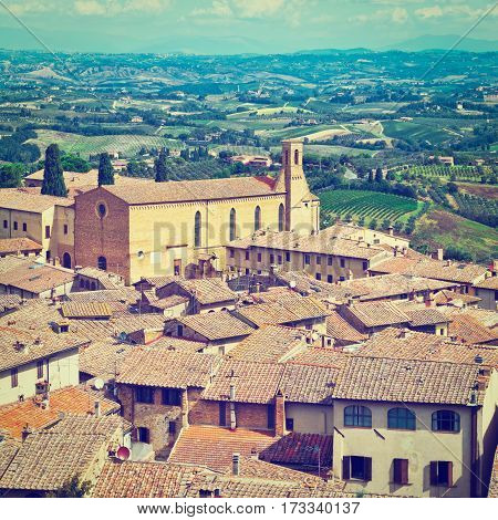 Aerial View of the Medieval City Gimignano and Surrounding Tuscan Landscape in Italy Instagram Effect