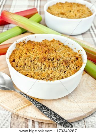 Crumble Rhubarb In White Bowl On Linen Tablecloths