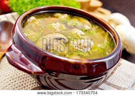 Soup With Meatballs And Mushrooms In Clay Bowl On Board