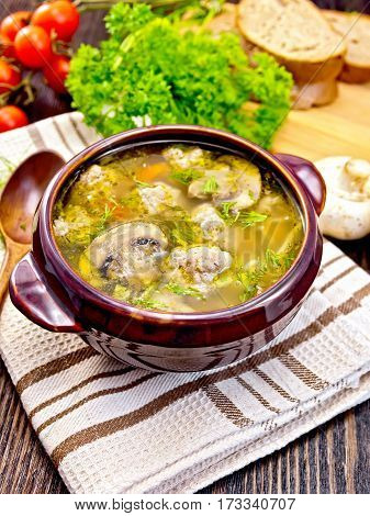 Soup With Meatballs And Mushrooms In Brown Bowl On Board