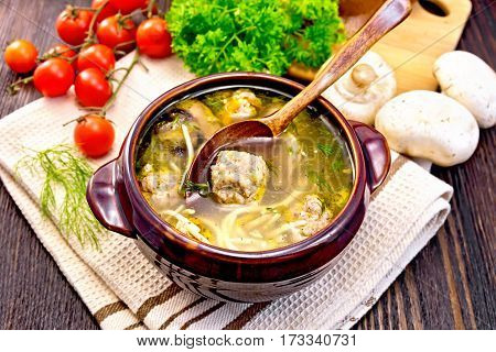 Soup With Meatballs And Spoon In Clay Bowl On Napkin