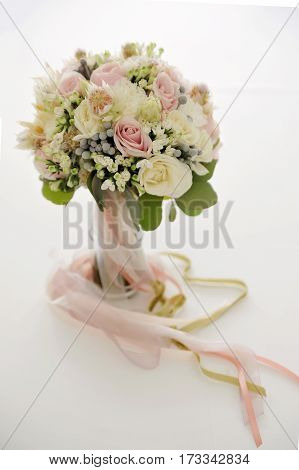 Awesome bridal bouquet of white and pink roses and other flowers