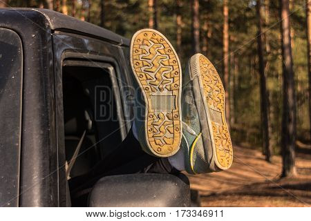 female feet in the window, off road vehicle