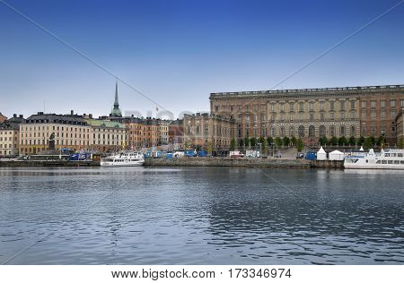 STOCKHOLM SWEDEN - AUGUST 20 2016: View of Gamla Stan and The Royal Palace. Stockholm Royal Palace is major royal palace of Swedish monarch in Stockholm in Stockholm Sweden on August 20 2016.