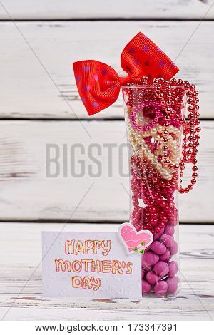 Beads, sweets and card. Gift for mother from heart.