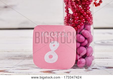 Greeting card and sweets. Bright present for Women's day.