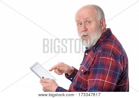 Senior bald and bearded white haired man touching something at tablet computer screen, isolated on white background