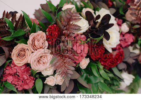 Wedding dicorating bouquet of white and pink roses and different petals, closeup