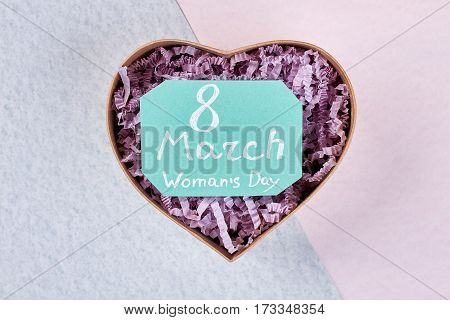 Heart-shaped box for a present. Congratulation with 8 of March.