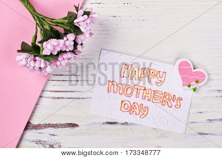 Card, flowers and heart. Greetings to my beloved mother.