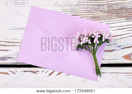 Envelope and bunch of flowers. Love confession letter.