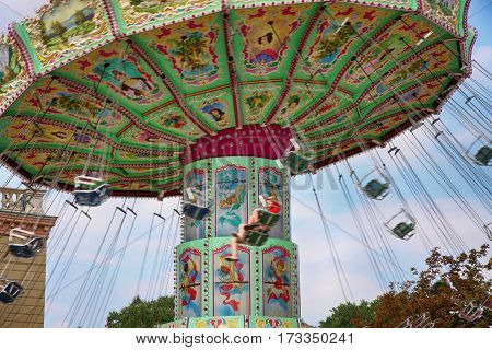VIENNA AUSTRIA - AUGUST 17 2012: View of Merry-go-round spinning in the Prater amusement park in Vienna Austria on August 17 2012.