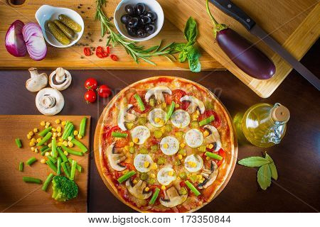 Tasty, flavorful pizza isolated on white background view on top. Delicious italian pizza served on wooden table. Tasty flavorful pizza isolated on white background view on top.