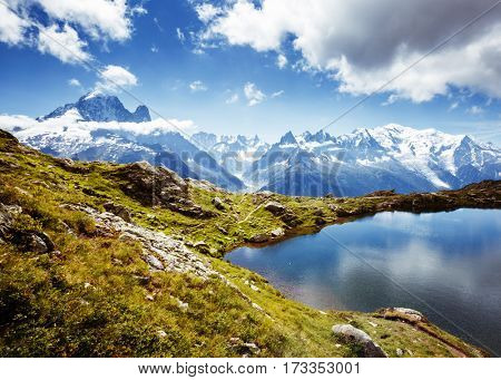 Views of the Mont Blanc glacier with Lac Blanc. Popular tourist attraction. Picturesque and gorgeous scene. Location place Nature Reserve Aiguilles Rouges, Graian Alps, France, Europe. Beauty world.