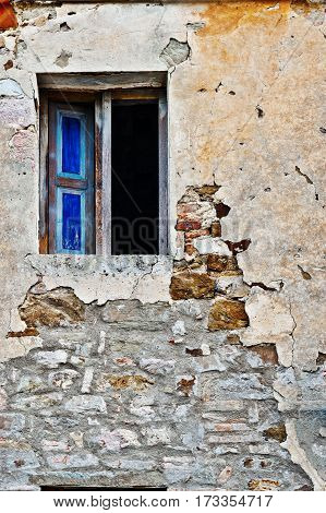 Open Window on the Dilapidated Facade of the Old Italian House