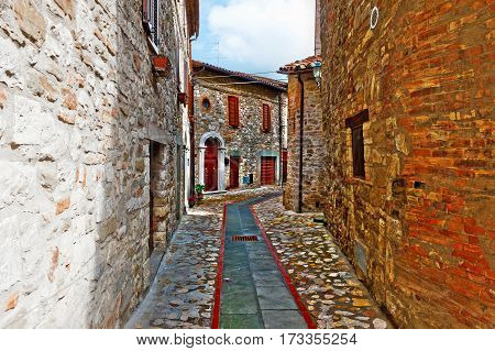 Narrow Street with Old Buildings in Italian City of Doglio