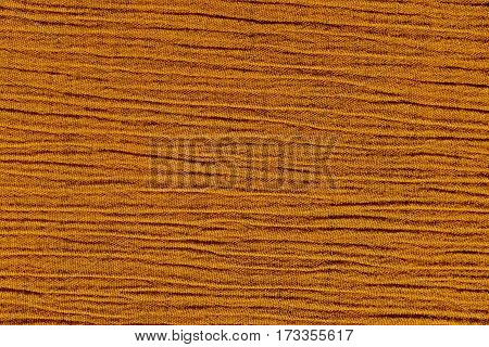 Gold ochre crinkled material with irregular horizontal lines fabric abstract background texture