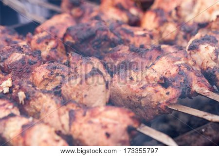 Grilling skewers or shashlik on barbecue grill. Selective focus.
