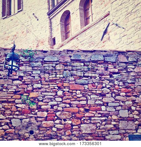 Old Wall on the Background of the Buildings in the Italian Medieval City Instagram Effect