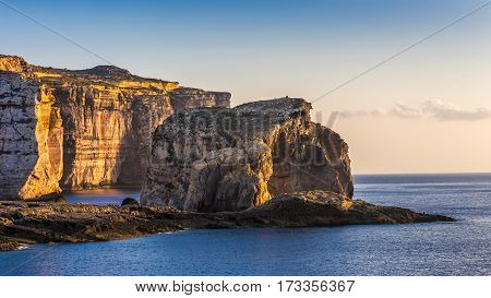 Gozo Malta - The famous Fungus rock on the island of Gozo at Dwejra bay at sunset