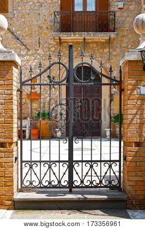 Steel Gate Leading into the Courtyard of Old Italian House