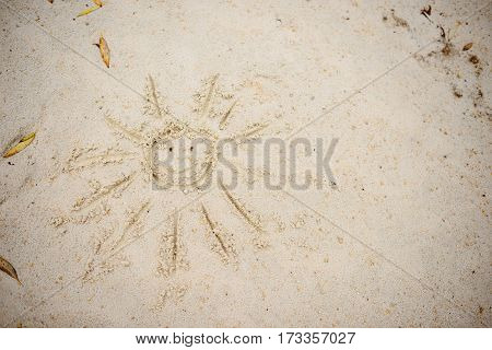 Sun Drawn In The Sand On A Beach