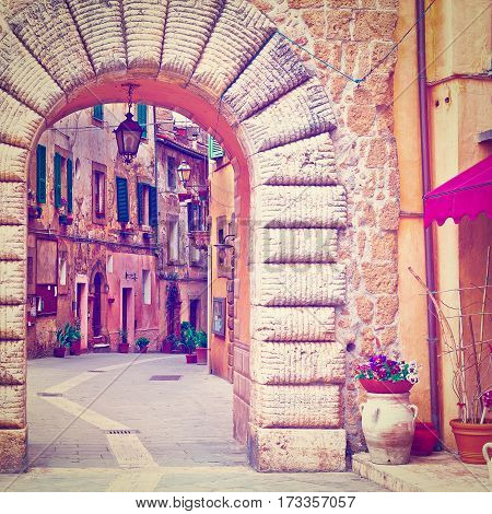 Arch of the Narrow Street with Old Buildings in the Medieval Italian City Instagram Effect
