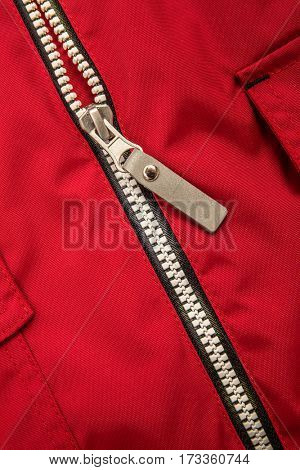 Close up zipper on a red background