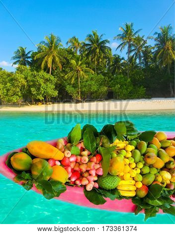 Exotic tropical fruits on the sandy tropical beach. Collage