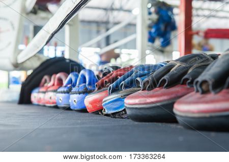 Row Of Thai Boxing Mitt Training Target Focus Punch Pad Glove On Canvas Ring In Gym Or Camp