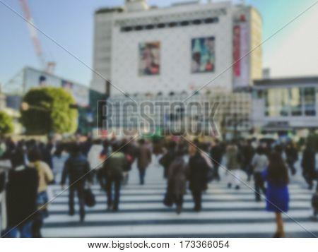 Abstract blur . People walking in Shibuya Crossing in Tokyo Japan.