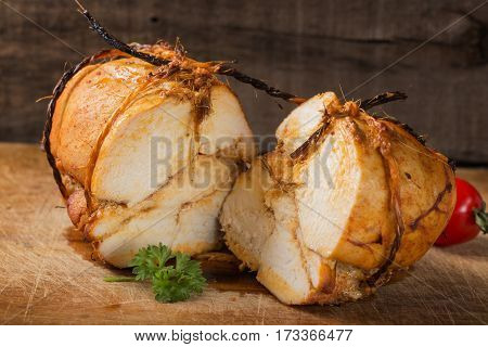 Close up of homemade chicken pastrami on wooden background