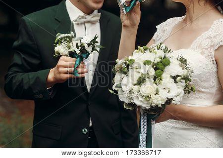 Stylish Wedding Couple Toasting Holding Glasses Of Champagne. Moment Of Wedding Reception Of Gorgeou