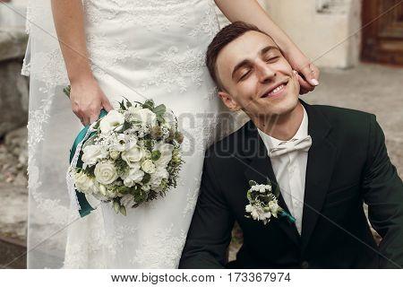 Happy Gorgeous Bride Caress And Hugging Happy Stylish Groom. Emotional Moment Of Beautiful Wedding C