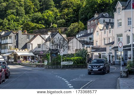 Lynmouth Devon England 13 July 2016: View of the street in the Riverside Road and Lynmouth street. Parked car. Against the backdrop of hills covered by forests. North Devon Coast.